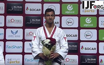 Israeli gold-medalist judoka Tal Flicker stands on the podium at the Judo Grand Slam in Abu Dhabi, where the local judo authorities banned the display of all Israeli symbols, on October 26, 2017. (YouTube screen capture)