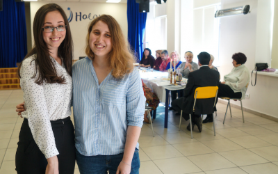 Head of the volunteer department, Alla Shakhova, left, with volunteer Adrianna Golubka, right, at the Halom Jewish Community Center in Kiev, Ukraine, September 8, 2017. (Cnaan Liphshiz/JTA)
