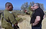 Defense Minister Avigdor Liberman, right, visits the Gaza Strip border with the head of the IDF's Gaza Division Brig. Gen. Yehuda Fuchs, center, and Southern Command chief Maj. Gen. Eyal Zamir on October 25, 2017. (Ariel Hermoni/Defense Ministry)