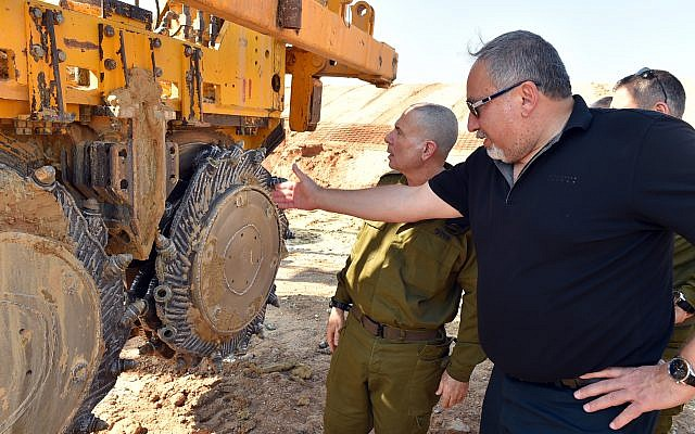 Defense Minister Avigdor Liberman and Brig. Gen. (res.) Eran Ofir visit a construction site where a new underground barrier is being constructed along the Gaza border in southern Israel on October 25, 2017. (Ariel Hermoni/Defense Ministry)