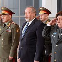 Russian Defense Minister Sergey Shoigu, left, Avigdor Liberman, center, and IDF Chief of Staff Gadi Eisenkot take part in an honor guard at the Israeli army's Kirya headquarters in Tel Aviv on October 16, 2017. (Ariel Hermoni/ Defense Ministry)