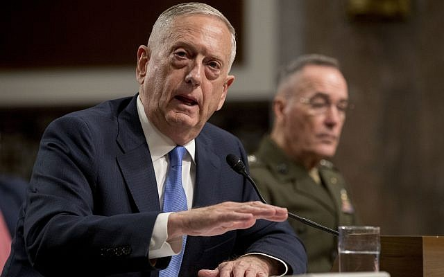 Defense Secretary Jim Mattis, left, accompanied by Joint Chiefs Chairman Gen. Joseph Dunford, speaks on Afghanistan before the Senate Armed Services Committee on Capitol Hill in Washington, October 3, 2017. (AP Photo/Andrew Harnik)