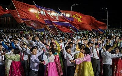 In a photo taken on October 8, 2017, participants described as 'working people, youth, and students of Pyongyang' perform during a mass gala event marking the 20th anniversary of late North Korean leader Kim Jong Il's election as general secretary of the Workers' Party of Korea (WPK) on Kim Il-Sung square in central Pyongyang. (AFP PHOTO / KIM Won-Jin)