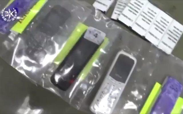 Illustrative: Smuggled cellphones discovered in an Israeli prison, October 2017 (Israel Police)