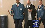 Rabbi Samuel Hiller leaves the New York court house on October 17, 2017. (Screen capture/YouTube)