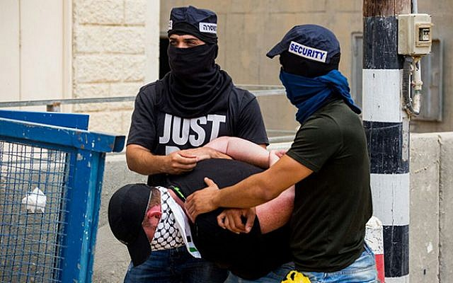 Undercover police officers arrest a Palestinian man in Israel illegally who is suspected of planning a stabbing attack, in Rahat, southern Israel, October 11, 2017. (Israel Police)