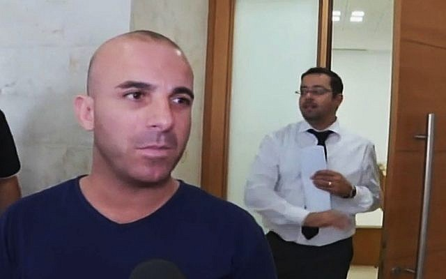 A Palestinian truck driver who says he stole a truck with the intention of running over Israeli soldiers is brought to an Israeli courthouse (screenshot Channel 2 news)