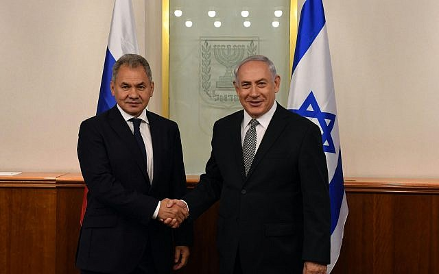 Prime Minister Benjamin Netanyahu, right, shakes hands with Russian Defense Minister Sergei Shoigu at a meeting in the former's office in Jerusalem on October 17, 2017. (Prime Minister's Office)