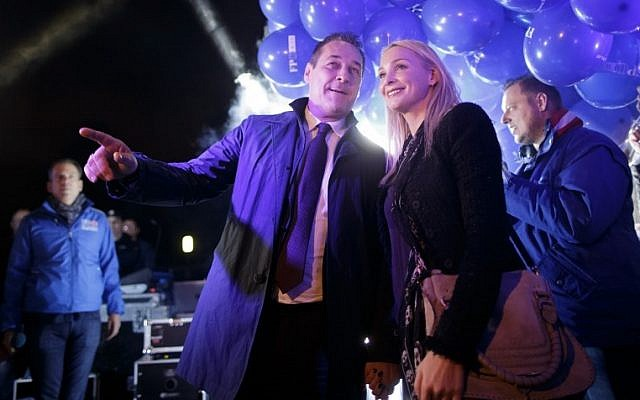 Leader of the right-wing Austrian Freedom Party (FPOe) Heinz-Christian Strache and his wife Philippa Strache arrive for a TV debate on October 10, 2017 in Vienna in the run-up to Austrian federal elections on 15 October 2017. (AFP/APA/Georg Hochmuth/Austria Out)