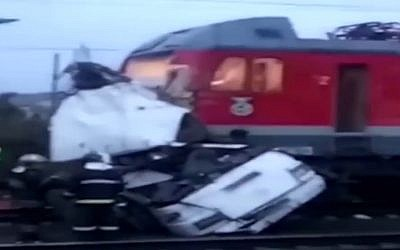 Aftermath of a train smashed into a bus which had broken down at level crossing in Russia, October 6, 2017. (Screen capture: YouTube)
