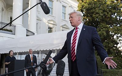 US President Donald Trump speaking to the media before boarding Marine One on the South Lawn of the White House, October 7, 2017. (Shawn Thew-Pool/Getty Images via JTA)