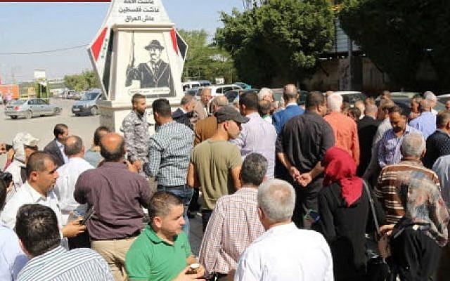 Inauguration ceremony of memorial to Saddam Hussein in the West Bank city of Qalqilya on October 18, 2017. (Qalqilya Municipality Facebook page)