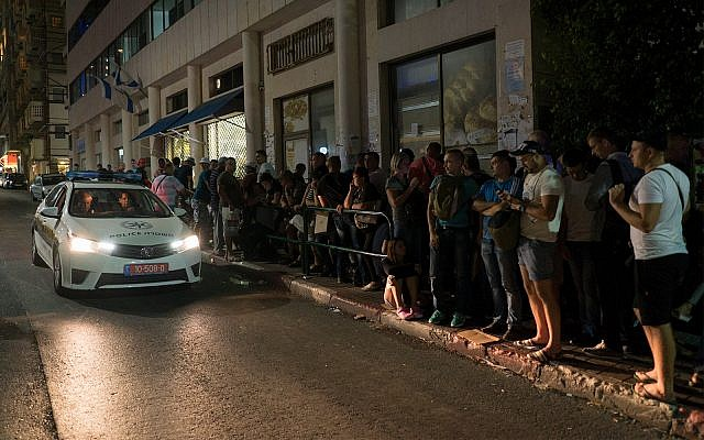 The line late at night outside the office of the Population Immigration and Border Authority, September 29, 2017. (Luke Tress/Times of Israel)
