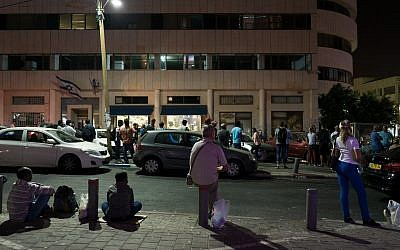 The line late at night outside the office of the Population Immigration and Borders Authority, September 29, 2017. (Luke Tress/Times of Israel)