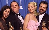 Harvey Weinstein (second from left) celebrates with Gwyneth Paltrow (second from right) after receiving the Oscar for best picture for 'Shakespeare In Love' during the 71st Annual Academy Awards Sunday, March 21, 1999, at the Dorothy Chandler Pavilion of the Los Angeles Music Center (AP Photo/Dave Caulkin)