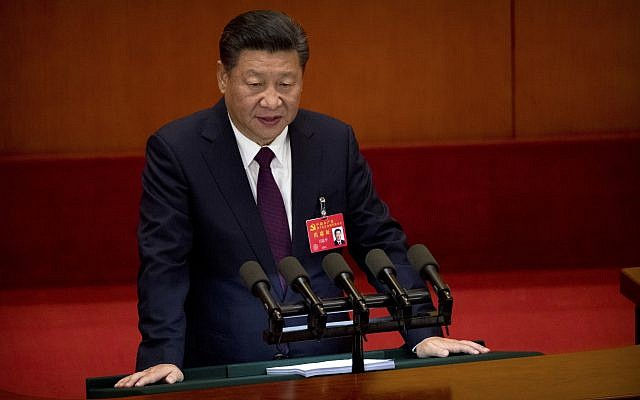 Chinese President Xi Jinping delivers a speech during the opening session of China's 19th Party Congress at the Great Hall of the People in Beijing, Wednesday, Oct. 18, 2017. (AP Photo/Mark Schiefelbein)