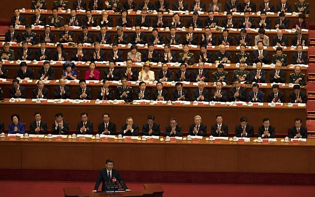 Chinese President Xi Jinping delivers a speech at the opening ceremony of the 19th Party Congress held at the Great Hall of the People in Beijing, China, Wednesday, Oct. 18, 2017. (AP Photo/Ng Han Guan)