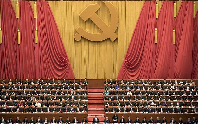 Chinese President Xi Jinping, center, presides over the opening ceremony of the 19th Party Congress held at the Great Hall of the People in Beijing Wednesday, Oct. 18, 2017. (AP Photo/Ng Han Guan)