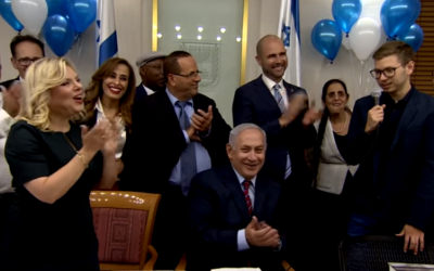 Yair Netanyahu (R) speaking during a 68th birthday party for his father, Prime Minister Benjamin Netanyahu (C), October 26, 2017. (Screen capture: YouTube)