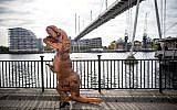 Illustrative: A cosplayer dressed as a dinosaur attends the MCM Comic Con at ExCeL exhibition centre in London on October 28, 2017. (AFP/Tolga AKMEN)