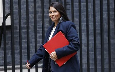 Britain's International Development Secretary Priti Patel arrives at 10 Downing Street for the weekly meeting of the cabinet in central London on October 31, 2017. AFP PHOTO / Tolga AKMEN)
