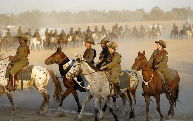 Members of the Australian Light Horse association ride near Beersheba in the southern Israeli desert on October 31, 2017 during a centennial reenactment of the historical fight of the ANZAC (Australian and New Zealand Mounted Division), which captured the area from the Ottoman Empire during the First World War. (AFP PHOTO / MENAHEM KAHANA)
