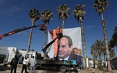 Illustrative: A portrait of Egyptian President Abdel Fattah el-Sissi hangs at the Rafah border crossing between Egypt and Gaza on November 1, 2017. (AFP Photo/Said Khatib)