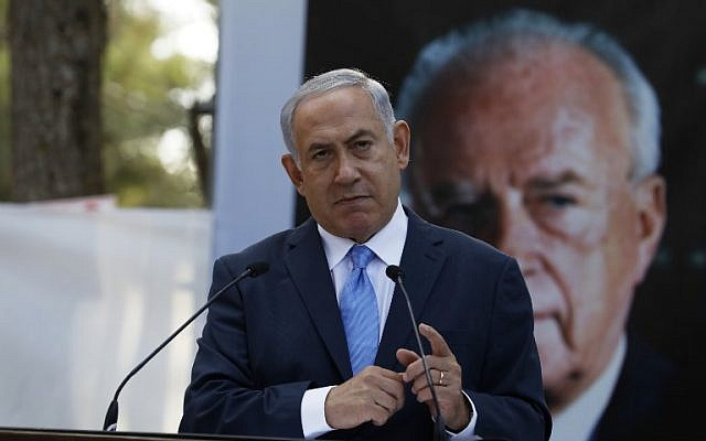 Prime Minister Benjamin Netanyahu speaks during a memorial ceremony to mark the 22nd anniversary of the assassination of former prime minister Yitzhak Rabin at the military cemetery on Mount Herzl in Jerusalem, on November 1, 2017. (AFP/Pool/Ronen Zvulun/ File)