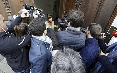 The wife of Paul Bekaert, lawyer of Catalan separatist leader Carles Puigdemont, speaks to the press from the doorstep of their house, following the announcement of the cancelled press conference of Catalan leader, on November 1, 2017, in Tielt. (AFP PHOTO / BELGA / NICOLAS MAETERLINCK)
