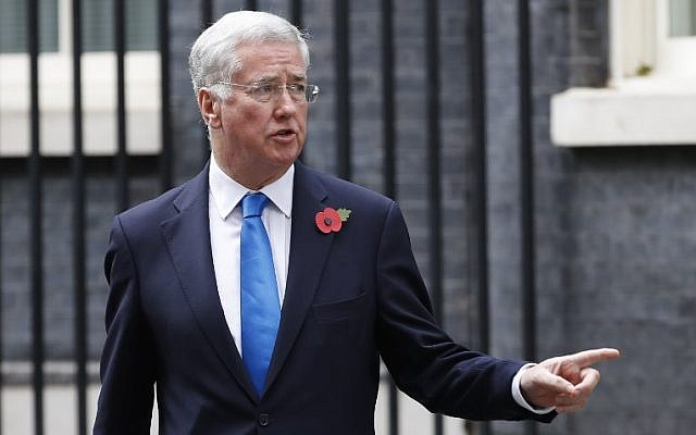 This file photo taken on October 31, 2017 shows Britain's Defense Secretary Michael Fallon leaving 10 Downing Street after the weekly meeting of the cabinet in central London. (AFP PHOTO / Tolga AKMEN)