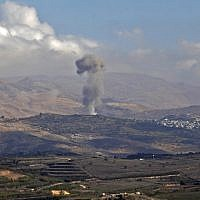 Illustrative: Smokes billows from the southern Syrian Druze village of Hadar on November 3, 2017, as seen from the Israeli Golan Heights. (AFP/JALAA MAREY)