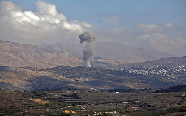 Smokes billows from the southern Syrian Druze village of Hadar on November 3, 2017, as seen from the Israeli Golan Heights. (AFP/JALAA MAREY)