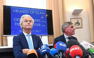 Illustrative: Dutch far-right politician Geert Wilders (L) and right-wing Belgium Flemish nationalist politician Filip Dewinter hold a press conference in Brussels on November 3, 2017. (Emmanuel Dunand/AFP)