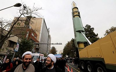 Iranians gather next to a replica of a medium-range ballistic missile during a demonstration outside the former US embassy in the Iranian capital Tehran on November 4, 2017, marking the anniversary of its storming by student protesters that triggered a hostage crisis in 1979. (AFP Photo/Atta Kenare)