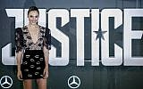 Israeli actress Gal Gadot poses at a photo shoot to promote the movie 'Justice League' on November 4, 2017, in London. (AFP Photo/Tolga Akmen)