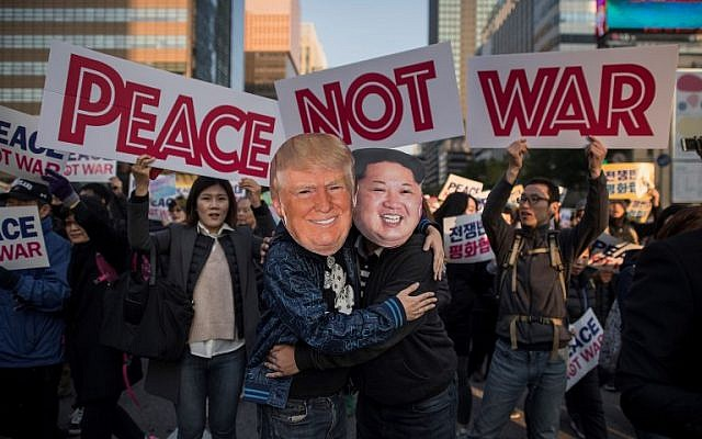 Demonstrators dressed as North Korean leader Kim Jong Un (R) and US President Donald Trump (L) embrace during a peace rally in Seoul on November 5, 2017.(AF/Ed Jones)