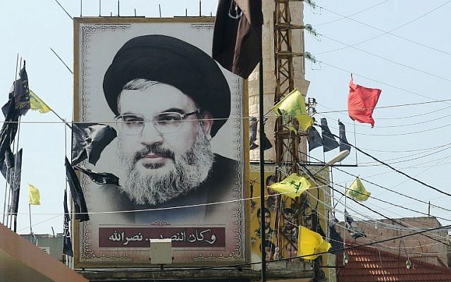 A portrait of the head of the Hezbollah terror group Hassan Nasrallah is seen on November 5, 2017, in the southern Lebanese village of Adshit. (AFP Photo/Mahmoud Zayyat)