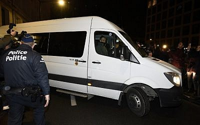 A van, presumed to be transporting the deposed Catalan leader, leaves the public prosecutor's office in Brussels on November 5, 2017. (AFP/ BELGA AND AFP/JOHN THYS)