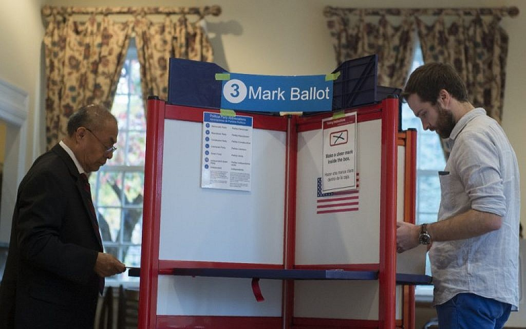 Two men vote at a polling station in Arlington, Virginia on November 7, 2017. (AFP / Andrew CABALLERO-REYNOLDS)