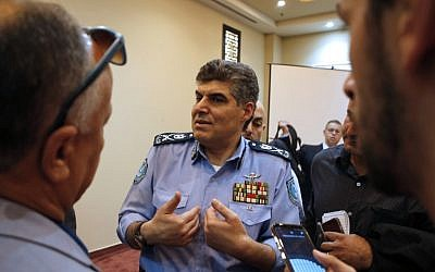 Major General Hazem Atallah (C), the head of the Palestinian police in the West Bank, speaks with journalists following a press conference in Ramallah on November 8, 2017. (Abbas Momani/AFP)