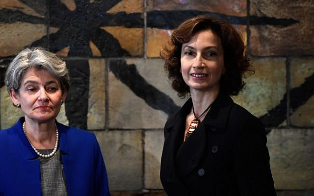 Former French culture minister Audrey Azoulay (R) stands with outgoing UNESCO director-general Irina Bokova at the UNESCO headquarters in Paris on November 10, 2017 after UNESCO member states approved her nomination to head of the cultural agency. (Eric Feferberg/AFP)