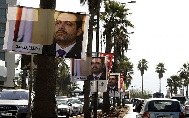 "Posters of Lebanese Prime Minister Saad Hariri hang on Beirut's seaside corniche on November 10, 2017, with a caption reading below in Arabic: ""#We_are_all_Saad."" (AFP PHOTO / JOSEPH EID)"