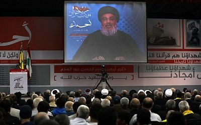 Hassan Nasrallah, the head of Lebanon's militant Shiite movement Hezbollah, giving a televised address during a gathering in Beirut's southern suburb, November 10, 2017. (AFP/ Anwar Amro)