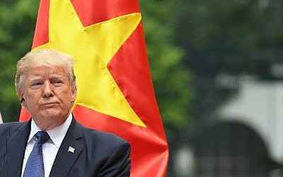 US President Donald Trump attends a joint press conference with his Vietnamese counterpart Tran Dai Quang at the Presidential Palace in Hanoi on November 12, 2017. (AFP PHOTO / JIM WATSON)