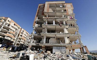 Illustrative: A picture taken on November 14, 2017, shows a buildings damaged by the 7.3-magnitude earthquake that struck two days before in the town of Sarpol-e Zahab in Iran's western Kermanshah province. (AFP Photo/Atta Kenare)