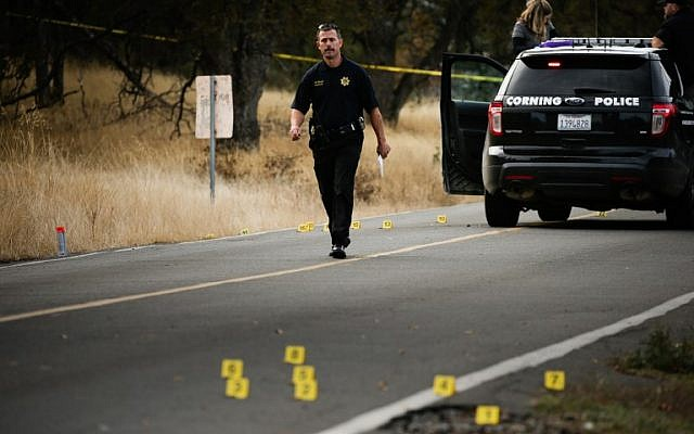 A law enforcement officer is seen at one of many crime scenes after a shooting on November 14, 2017, in Rancho Tehama, California. (AFP Photo/Elijah Nouvelage)
