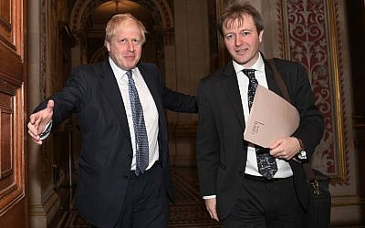 Britain's Foreign Secretary Boris Johnson, left, meets with Richard Ratcliffe, the husband of British-Iranian woman Nazanin Zaghari-Ratcliffe who is jailed in Iran, at the Foreign and Commonwealth Office in London, November 15, 2017. (AFP/Stefan Rousseau)