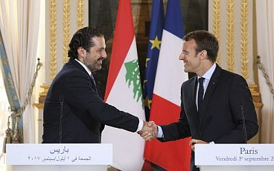 French President Emmanuel Macron, right, shaking hands with Lebanese Prime Minister Saad Hariri during a press conference at the Murat Lounge in the Elysee Palace in Paris, September 1, 2017.(AFP/ludovic MARIN)