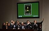 "Christie's employees take bids for Leonardo da Vinci's ""Salvator Mundi"" at Christie's New York on November 15, 2017. (AFP/TIMOTHY A. CLARY)"