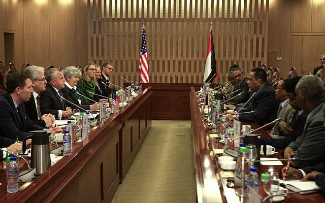 US Deputy Secretary of State John Sullivan (3rd left) meets with Sudanese Foreign Minister Ibrahim Ghandour (4th right) at the foreign ministry headquarters in the capital Khartoum on November 16, 2017. (AFP/ Ebrahim Hamid)
